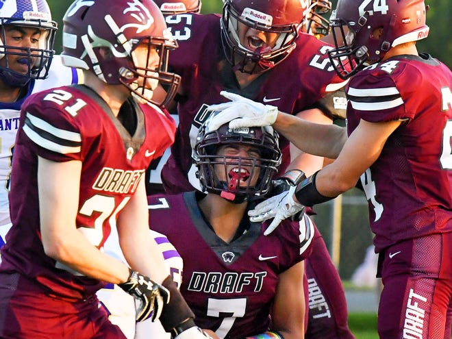 Stuarts Draft's Freddie Watkins celebrates his touchdown with teammates in the end zone during a football game played in Stuarts Draft on Friday, August 24, 2018.