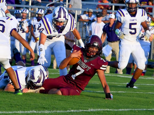 Stuarts Draft's Freddie Watkins is brought down with the ball during a football game played in Stuarts Draft on Friday, August 24, 2018.