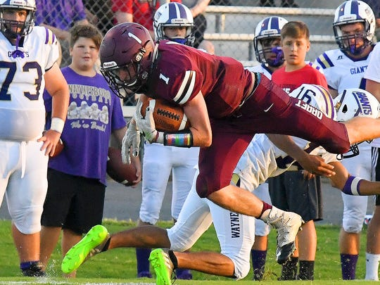 Stuarts Draft's Dustyn Fitzgerald is tripped up and goes down while running the ball during a football game played in Stuarts Draft on Friday, August 24, 2018.