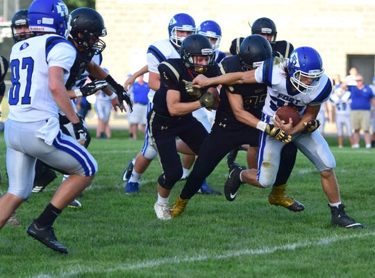Fort Defiance's Trevor Bartley is dragged down by a Buffalo Gap defender in the first quarter of their season opening football game at Buffalo Gap High School in Swoope, Va., on Friday, Aug. 24, 2018