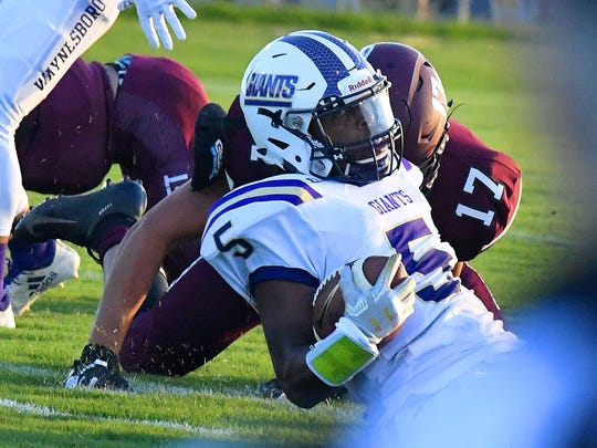 Waynesboro's Kazmaun Johnson goes down with the football during a football game played in Stuarts Draft on Friday, August 24, 2018.