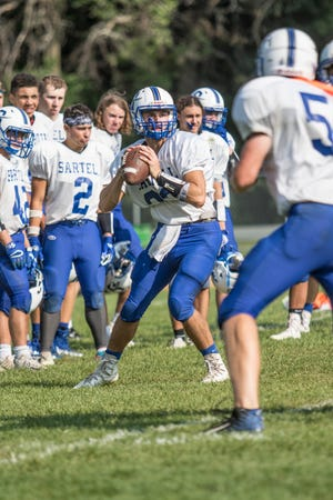 Senior quarterback Ryan Giguere waits for his receiver to break free during practice Thursday, Aug. 23, at Sartell High School.