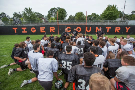 Tiger head coach Jon Benson fires his troops up as they wrap practice Thursday, Aug. 23, at Tech High School in St. Cloud.