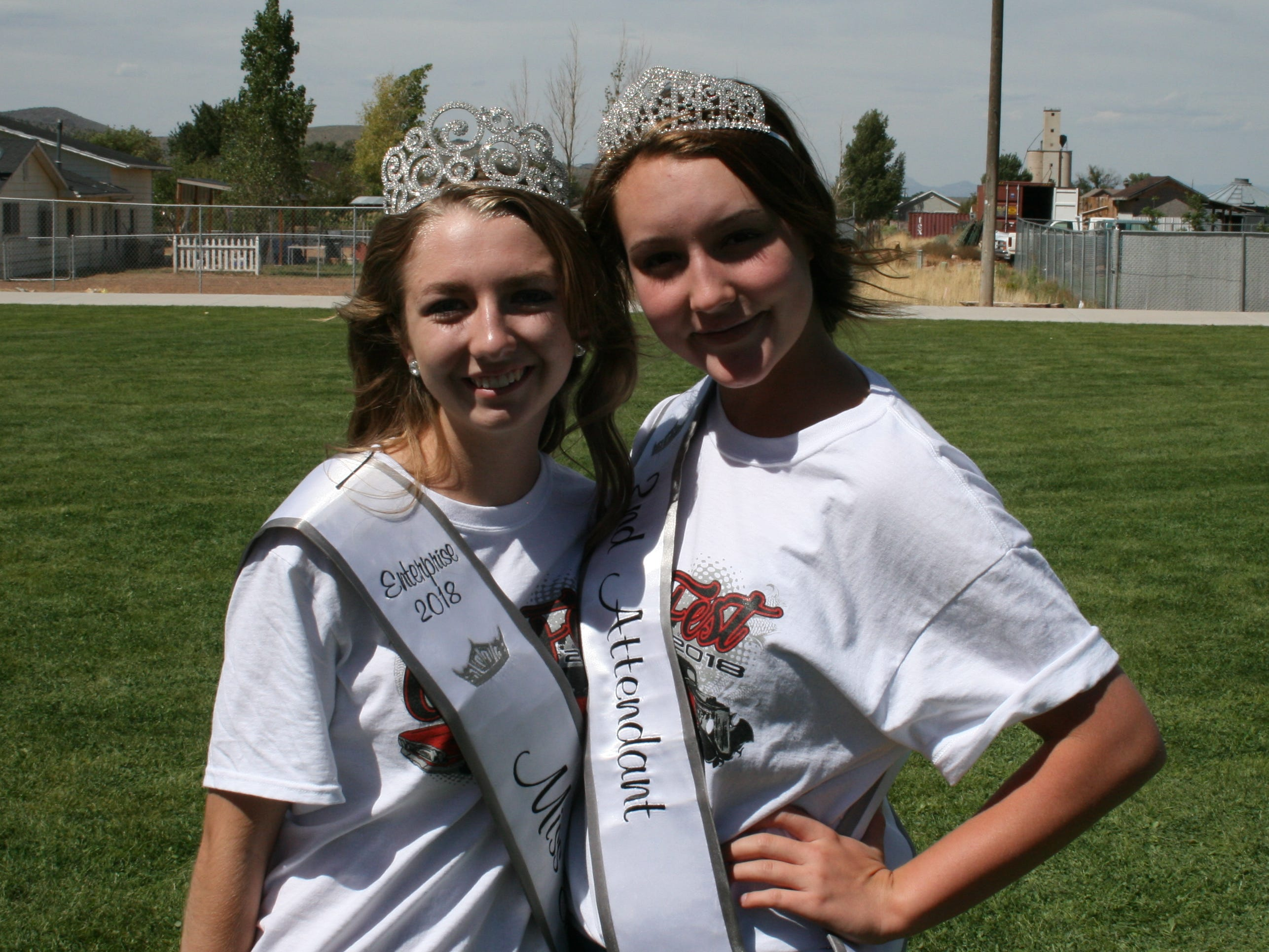Miss Enterprise 2018 Taysha Pedersen, left, and 2nd Attendant Dallee Cobb worked the information table at Cornfest on Aug. 25, 2018.