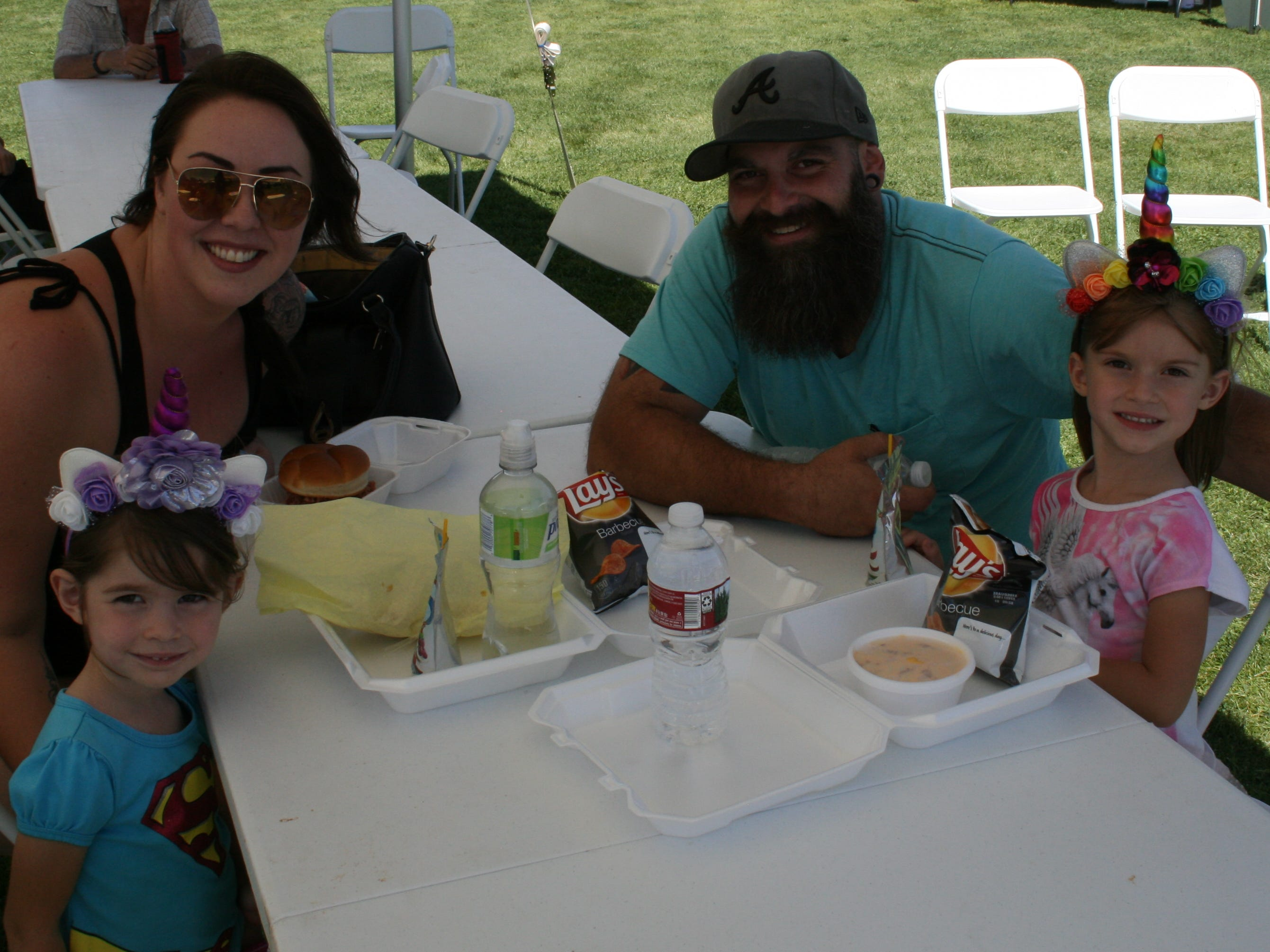 Anaveya, Maddy Carty, Matt Levitt and Jennabree eat lunch at Cornfest in Enterprise on Aug. 25, 2018.