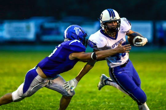 Amherst's Josh Rieck tackles St. Mary's Springs' Jake Hoch during a game between Amherst and St. Mary's Springs at Amherst High School in Amherst, Wis., August 24, 2018. The Ledgers defeated the Falcons 34-0.