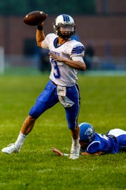 Saint Mary's Springs quarterback Mitchell Waechter looks for an open receiver during a nonconference game with Amherst on Friday night. The Ledgers defeated the Falcons 34-0.