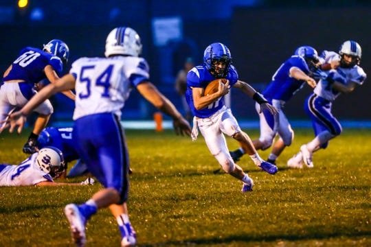Amherst quarterback Lincoln Cullen makes a run during a game with Saint Mary's Springs on Friday night. The Falcons were limited to 109 yards of total offense.