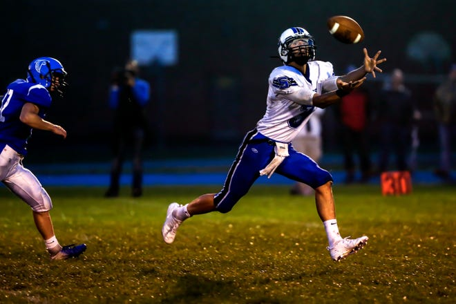 St. Mary's Springs' Mitch Waechter catches a pass during an Aug. 24 game against Amherst. The Ledgers are ranked No. 1 in the Small Division of the AP state football poll.