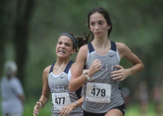Maclay's Sofia Paredes grimaces during the finish of the 2018 Cougar XC Invitational at Elinor Klapp-Phipps Park.