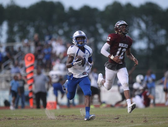 Godby's Alvin Jones returns a punt for a touchdown as Godby beat Chiles in the regular-season opener for both teams.