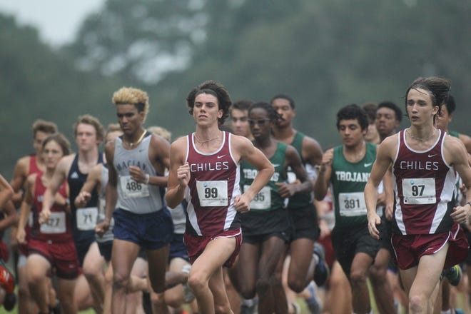 Chiles' Connor Phillips, with Maclay's Jay Brown over his right shoulder, starts during the 2018 Cougar XC Invitational at Elinor Klapp-Phipps Park.