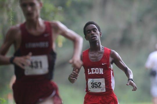 Leon's Joseph Ashebo runs at the 2018 Cougar XC Invitational at Elinor Klapp-Phipps Park.