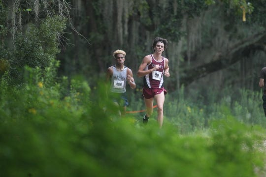 Chiles' Connor Phillips leads Maclay's Jay Brown to the finish of the 2018 Cougar XC Invitational at Elinor Klapp-Phipps Park.