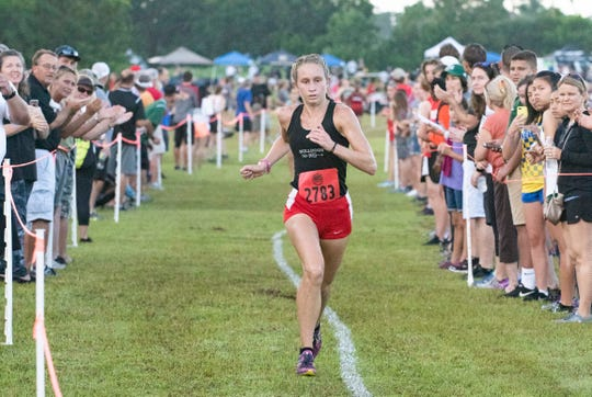 South Fork junior Hannah Martin makes her way to the finish line Saturday, August 25, 2018, during the Fleet Feet Invitational cross-country meet at South Fork High School in Stuart. Martin came in second with a time of 20:30.77. Emma Cavendish, not pictured, of Dwyer won the race with a time of 19:49.50. To see more photos, go to TCPalm.com.