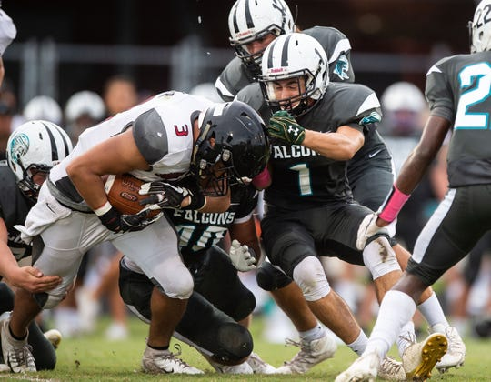Jensen Beach safety Liam Zaccheo (No. 1) makes a tackle against South Fork on Friday, Aug. 24, 2018 at Jensen Beach High School.