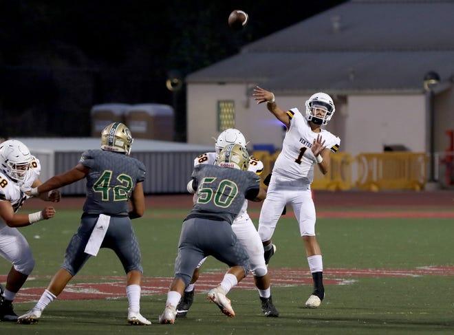 Ventura High quarterback Carson Willis fires a pass during Friday night's game at Santa Barbara. Willis threw three TD passes in the Cougars' season-opening loss.