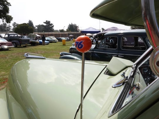 An old-school 76 ball adorns the antenna of a classic car on display at the Ventura Youth Correctional Facility on Saturday. A first-of-its kind event brought together incarcerated youth and volunteers from local car clubs.