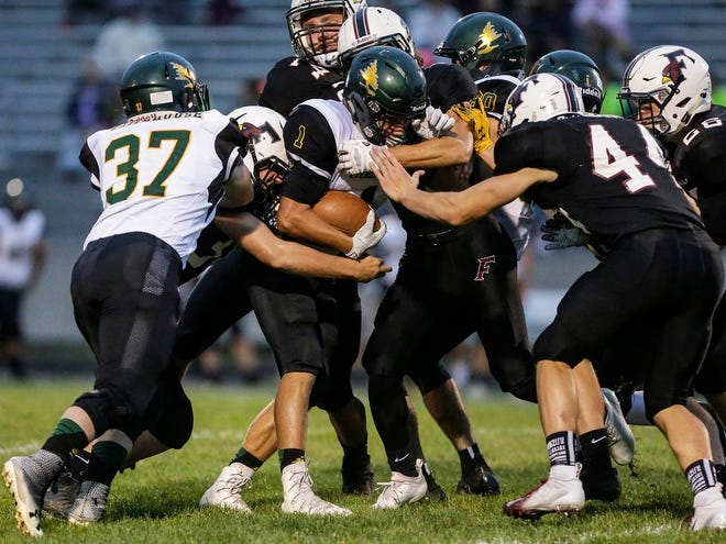 Fond du Lac High School football players tackle D.C. Everest's Jager Reissmann during their game Friday, August 24, 2018 at Fruth Field in Fond du Lac, Wisconsin.