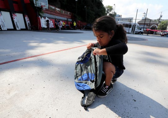 Samiyah Diaz, 4, checks out her new backpack in August 2018 as she visited the Nepperhan Community Center in Yonkers for a backpack and school supplies giveaway.