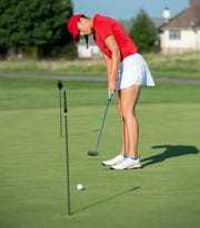 Haley Quickel sinks a practice putt at Back Creek Golf Club while preparing to represent the First Tee of Delaware in the Pure Insurance Championship, to be played Sept. 25-30 at Pebble Beach, California.