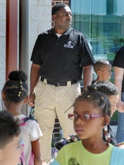 Capital School District constable Barry Gaines is busy at the end of the school day helping children while they wait for their parents. In-between he keeps his eyes open for anything suspicious.