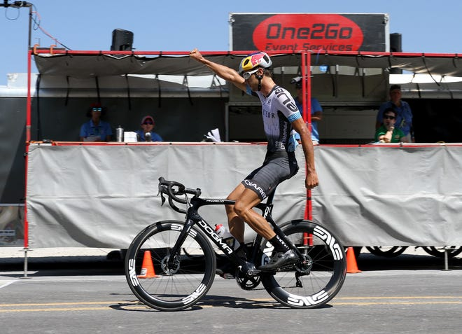 Meteor X Giordana's Colin Strickland holds his arm up in victory as he crosses the Men Pro 1-2 in first with a time of 4:16;03 Saturday, Aug. 25, 2018, at the Hotter'N Hell Hundred race finish at 310 Texas 79.