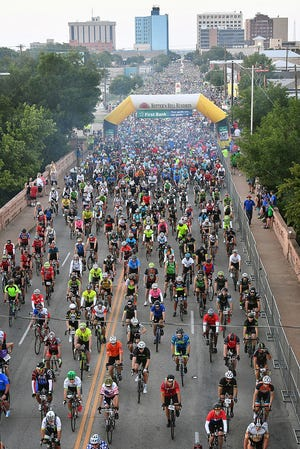 Thousands of riders start off the 37th Annual Hotter'N Hell Hundred Saturday morning from downtown Wichita Falls. The HHH is the largest century ride in the nation.