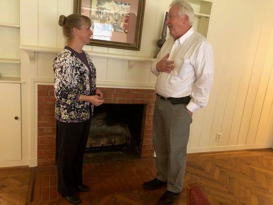 Dr. Kathy Zuckweiler, left, talks with Dave Hartman Thursday at the Lifelong Learning Center on Hampstead.