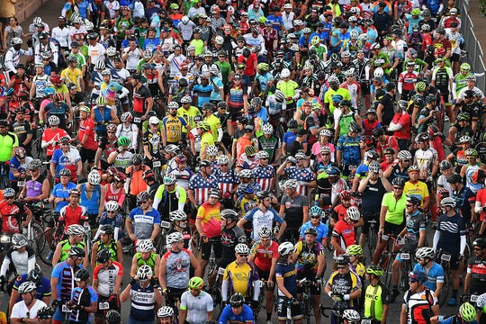 Thousands of cyclists await the start of the 37th Annual Hotter'N Hell Hundred Saturday morning in downtown Wichita Falls.
