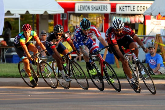 Racers ride in a pace line during the fixed gear criterium Friday night as the races kick off the 2018 HHH weekend.