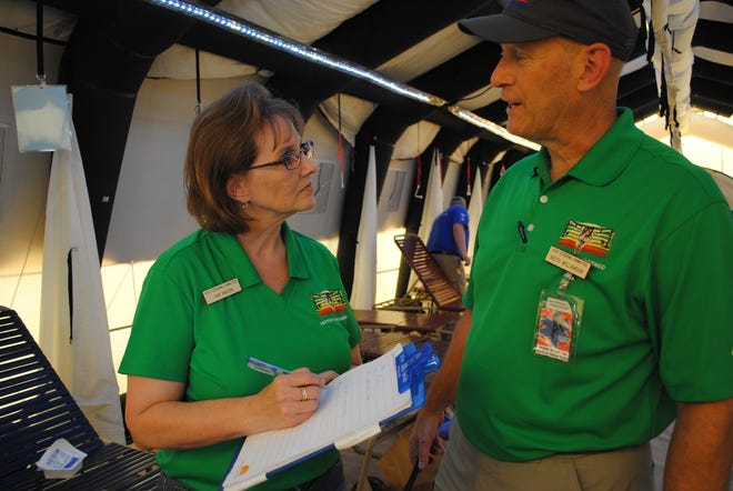 Kim Maddin, hospital liaison, left, talks with Dr. Keith Williamson, medical director, Saturday afternoon about an incoming patient inside an air-conditioned tent used for heat-related issues during Hotter'N Hell events. The tent was provided by the North Texas Regional Advisory Council. Despite hot temperatures and some wind, med teams reported low numbers of injuries this year and few major traumas.