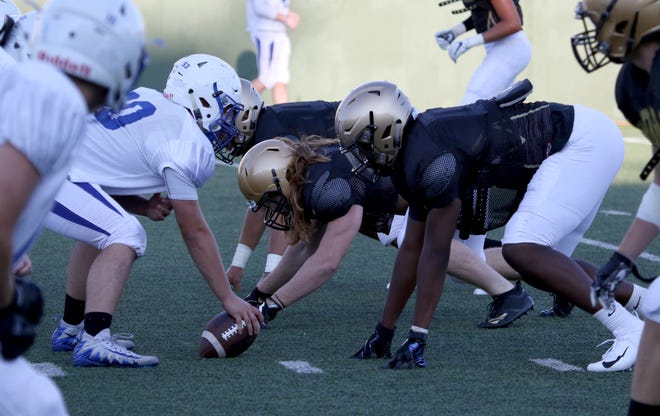 The Rider defense lines up against Decatur in a scrimmage Friday, Aug. 24, 2018, at Memorial Stadium.
