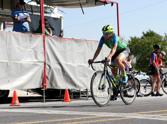 Team TIBCO-Silicon Valley's Emily Newsom crosses the finish line in second behind Wolfpack's Leigh Ann Ganzar Saturday, Aug. 25, 2018, at the Hotter'N Hell Hundred race finish at 310 Texas 79.