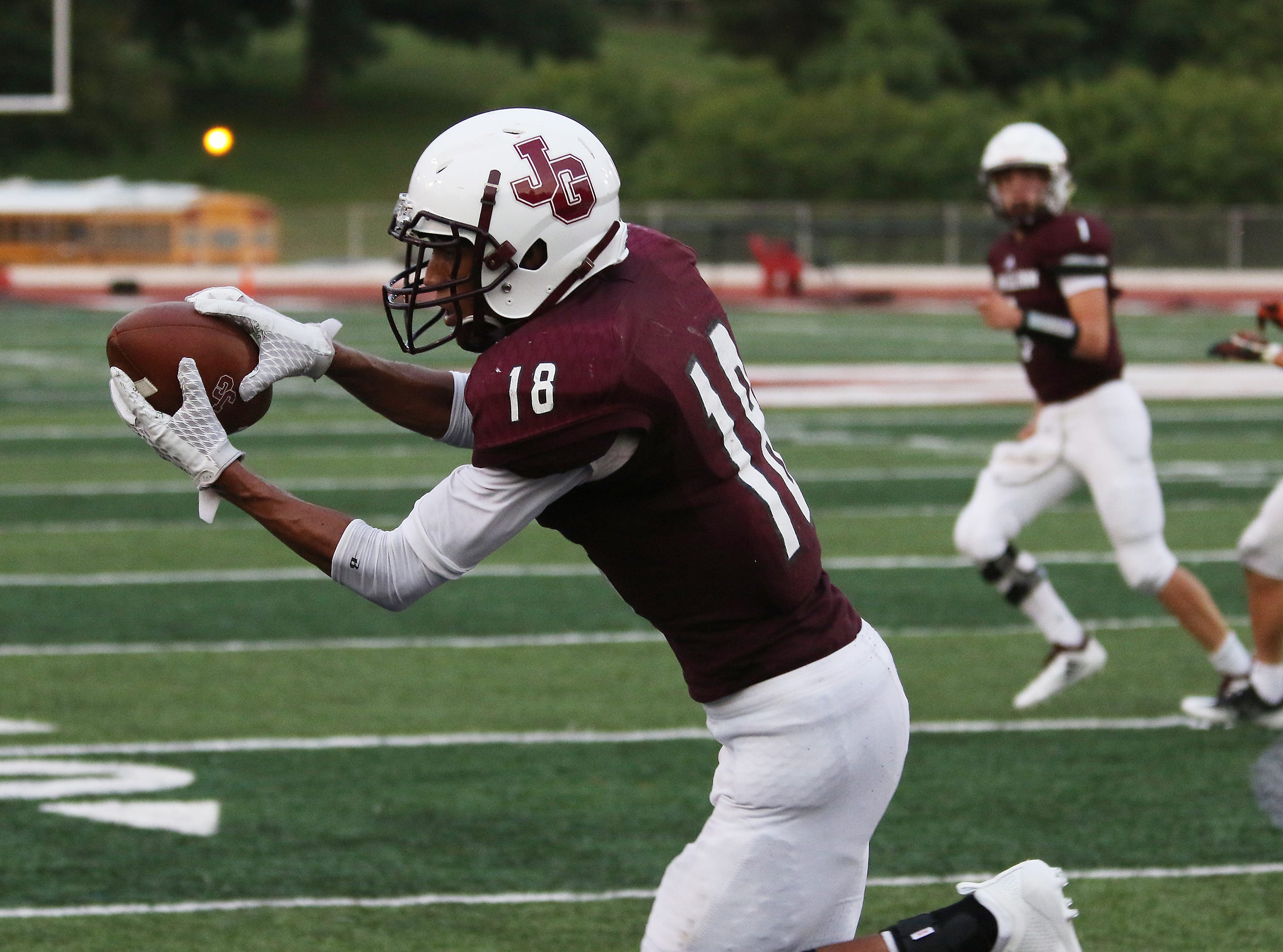 John Glenn's Joseph Clifford pulls in a two point conversion against Meadowbrook.