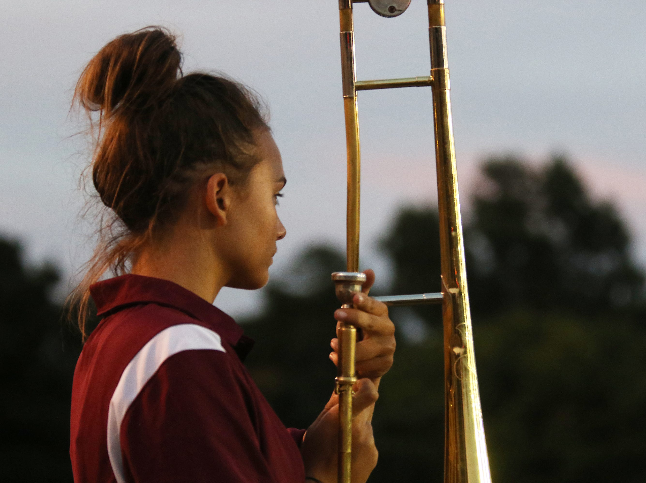 The John Glenn High School marching band performs during halftime against Meadowbrook.