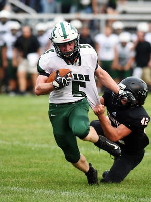 Nick Krooner breaks through a tackle en route to a 1-yard touchdown run during Fisher Catholic's 28-7 win against host Crooksville on Friday night at Village Park. Krooner also caught a 62-yard touchdown, as the Irish won their opener for the first time in nine years.