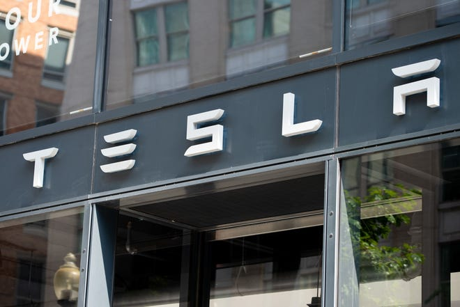 Tesla logo is pictured outside of their showroom in Washington, D.C.