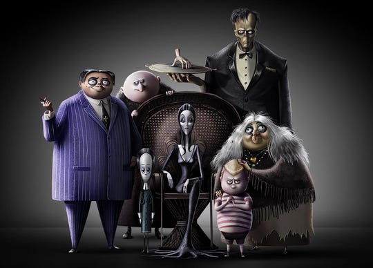 "Oscar Isaac voices the family patriarch Gomez Addams (left) in the upcoming animated ""The Addams Family."""