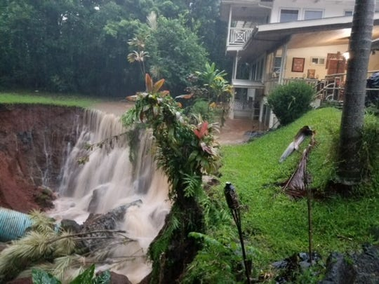 The former backyard of a house in the town of Papaikou just north of Hilo on the island of Hawaii. Heavy rains brought by Hurricane Lane caused a stream to overflow and wash the yard away.