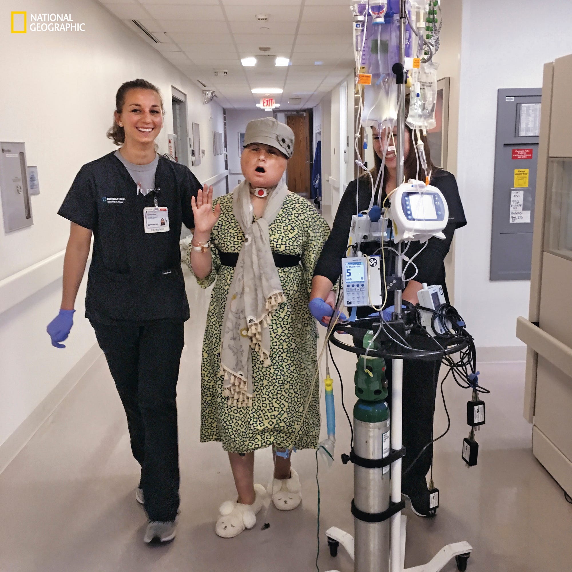 20 days after Katie's transplant On one of her daily walks in the hallways, Katie sings as she exercises with physical therapist Becky Vano (at left) and physical therapy student Nicole Bliss. Before the transplant, Katie had to learn to walk again to overcome spasticity in her limbs caused by the concussive injury to her brain. After the transplant, she had to start over with strengthening her legs.