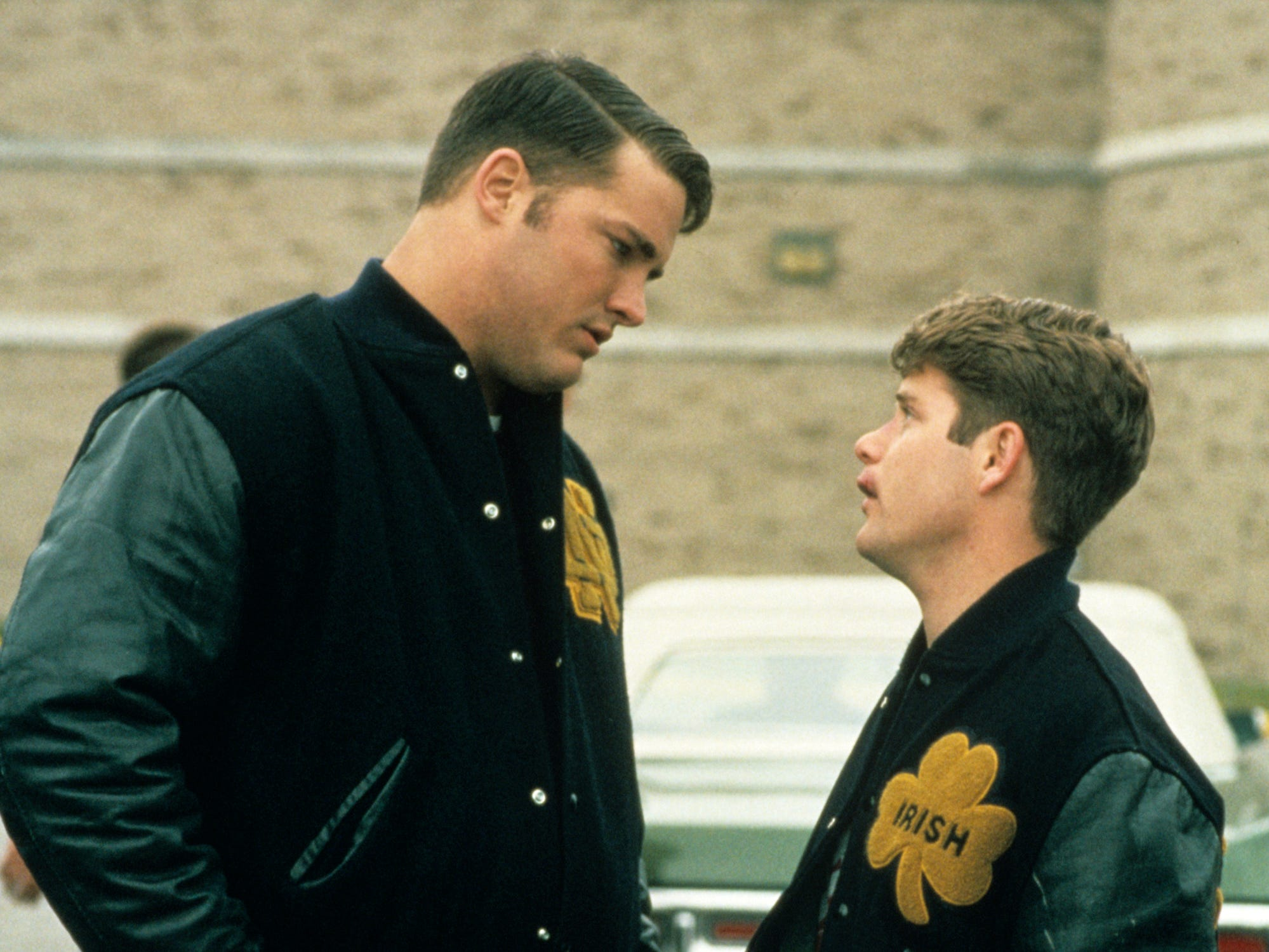 Rudy Ruettiger (Sean Astin), next to a Notre Dame player in the film, was considered too small to play college football.