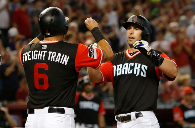 Arizona Diamondbacks' Paul Goldschmidt celebrates with David Peralta (6) after hitting a three-run home run against the Seattle Mariners in the third inning.