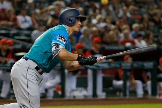 The Mariners' Kyle Seager drives in Seattle's first run with a first-inning single.
