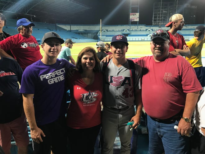 Former Rockledge High star Drew Parrish, third from left, is joined by his family in Cuba, where he pitched 5 shutout innings in a 5-1 win for Team USA.