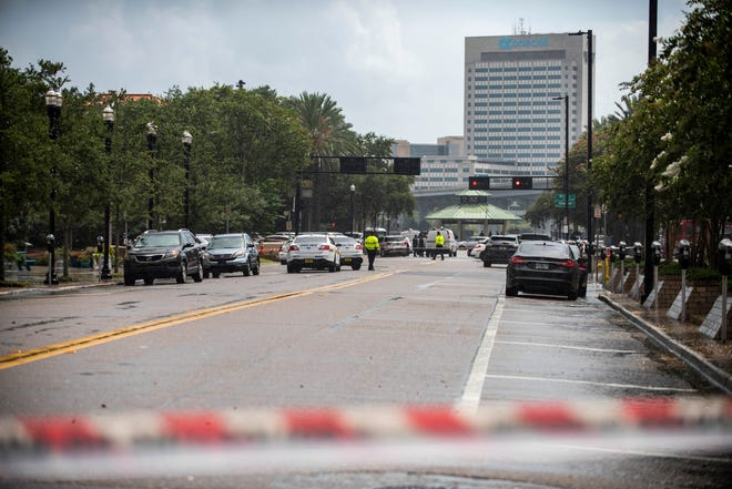 Police barricade a street near Jacksonville Landing in Jacksonville, Fla., Sunday, Aug. 26, 2018. Florida authorities are reporting multiple fatalities after a mass shooting at the riverfront mall in Jacksonville that was hosting a video game tournament. (AP Photo/Laura Heald)