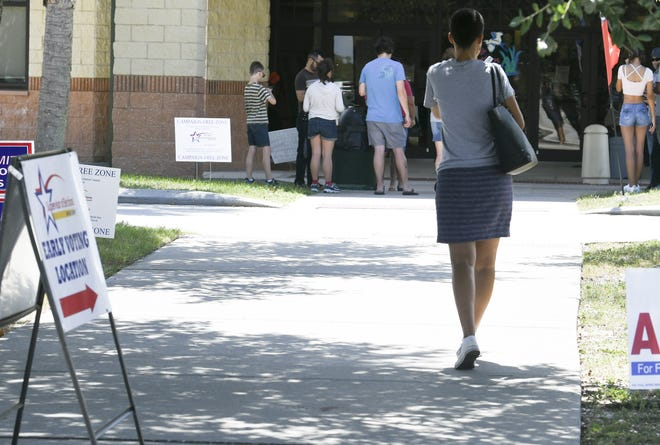 People stream in and out of the community center at Viera Regional Park during early in-person voting in advance of Tuesday's primary election.