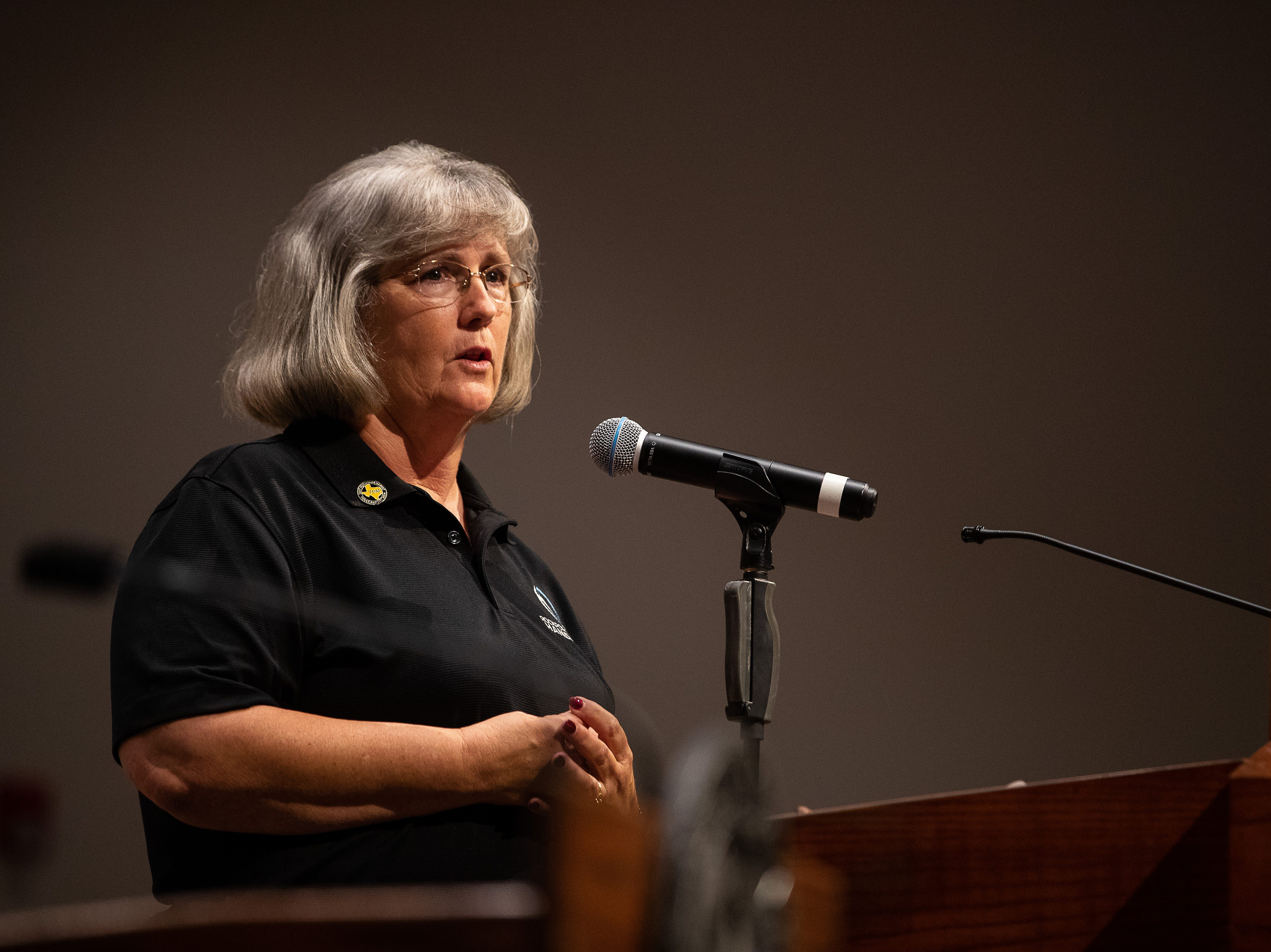 Hands of Hope director Cyndi Powell thanks volunteers at First Baptist Church of Rockport during a Hurricane Harvey anniversary service on Sunday, Aug. 26, 2018.