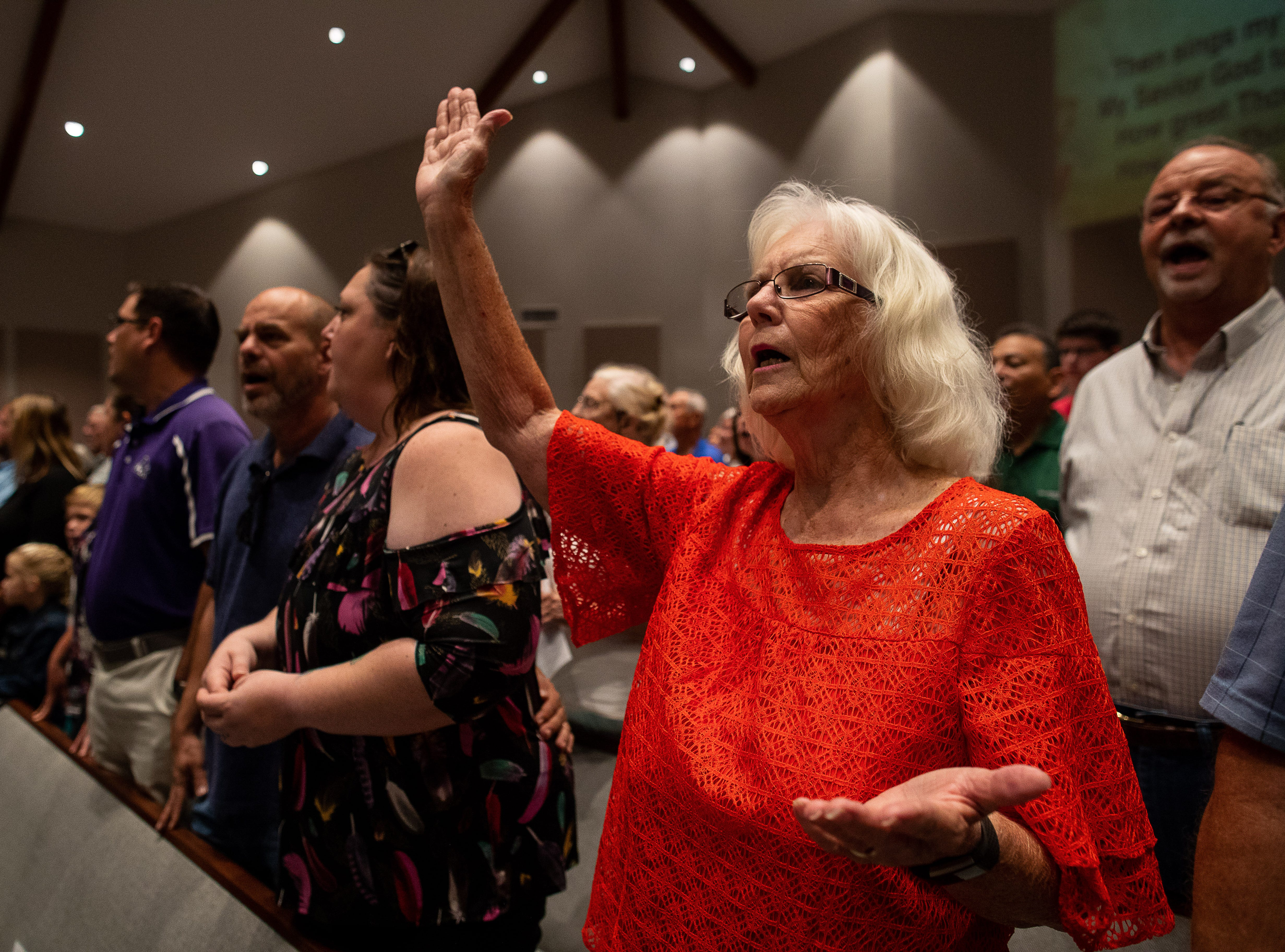 Members of First Baptist Church of Rockport pray during a Hurricane Harvey anniversary service on Sunday, Aug. 26, 2018.