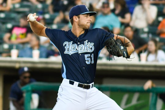 Hooks pitcher Corbin Martin throws during a game against the San Antonio Missions on Saturday, August 25, 2018.